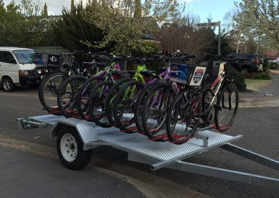 Bike trailer loaded up with colourful bikes at delivery address in Tanunda